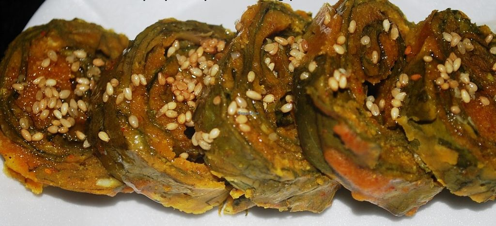 "Photo of Saattveek  by <a href=""/members/profile/saattveek"">saattveek</a> <br/>Alu Wadi - Taro leave interleaved with chick pea flour, tarmarind and tempered with linseed. Great VEGAN item with a tangy taste! <br/> June 12, 2016  - <a href='/contact/abuse/image/69252/153553'>Report</a>"