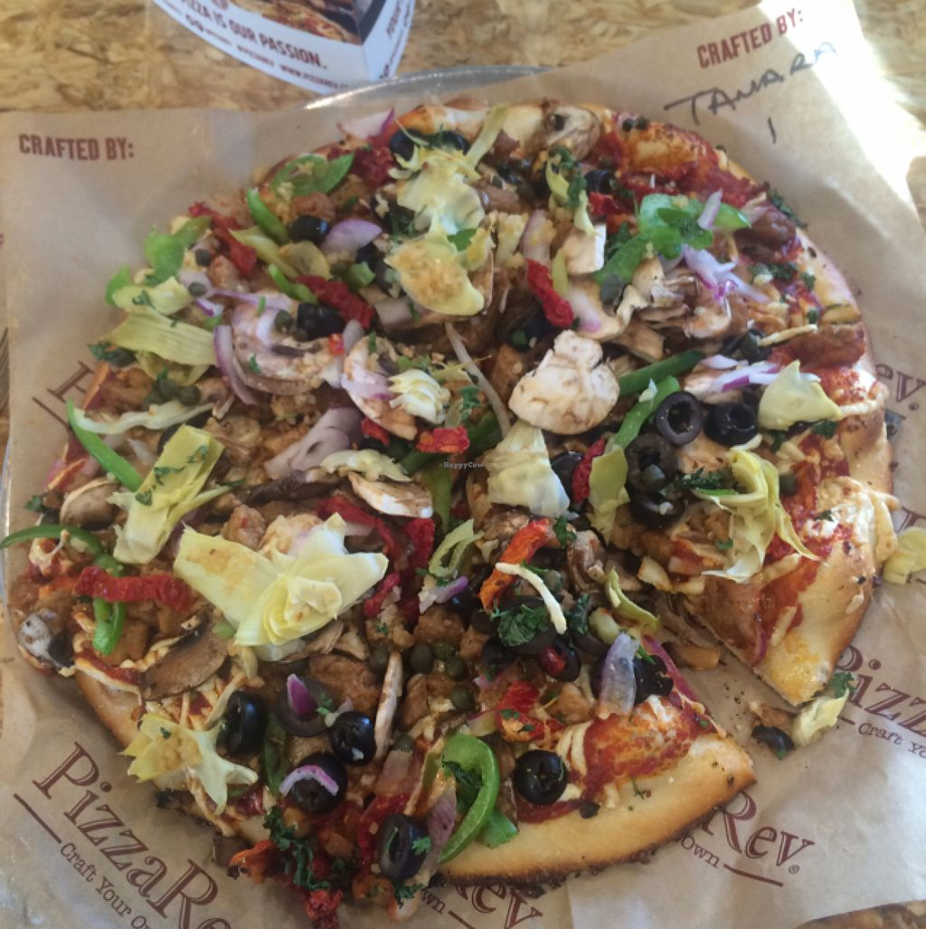 "Photo of PizzaRev  by <a href=""/members/profile/glassesgirl79"">glassesgirl79</a> <br/>Vegan pizza (with vegan cheese & sausage) from Pizzarev <br/> July 10, 2016  - <a href='/contact/abuse/image/69487/158806'>Report</a>"