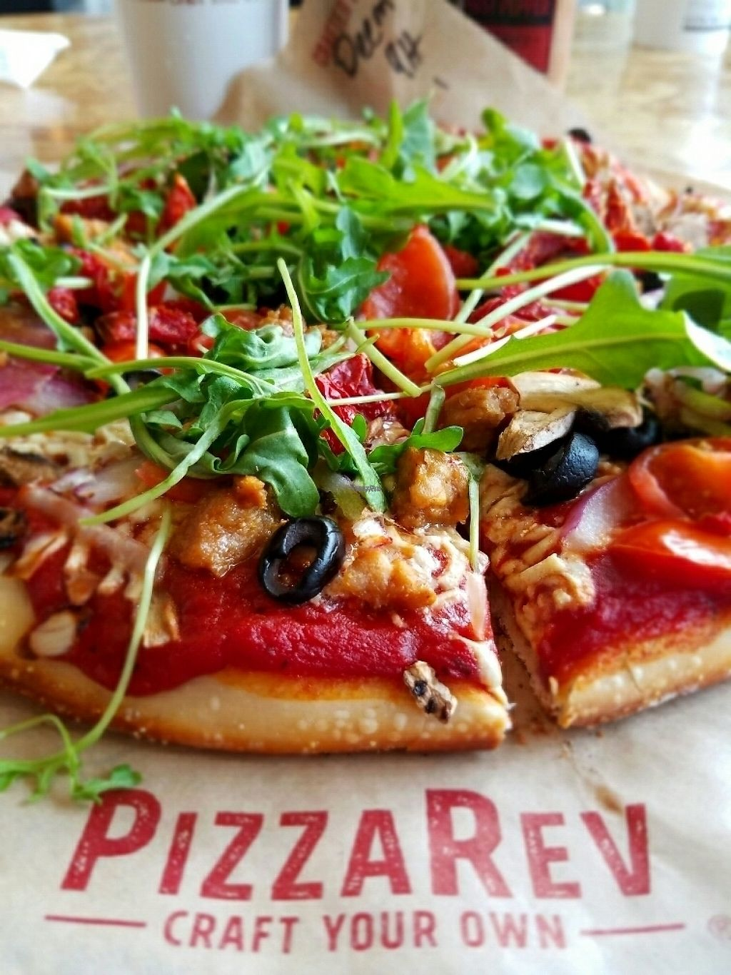 "Photo of PizzaRev  by <a href=""/members/profile/horseleach"">horseleach</a> <br/>Rocket, Sun-dried tomatoes, onion, mushrooms, olives, tomatoes, vegan sausage, vegan cheez, peppers <br/> February 22, 2017  - <a href='/contact/abuse/image/69487/229081'>Report</a>"
