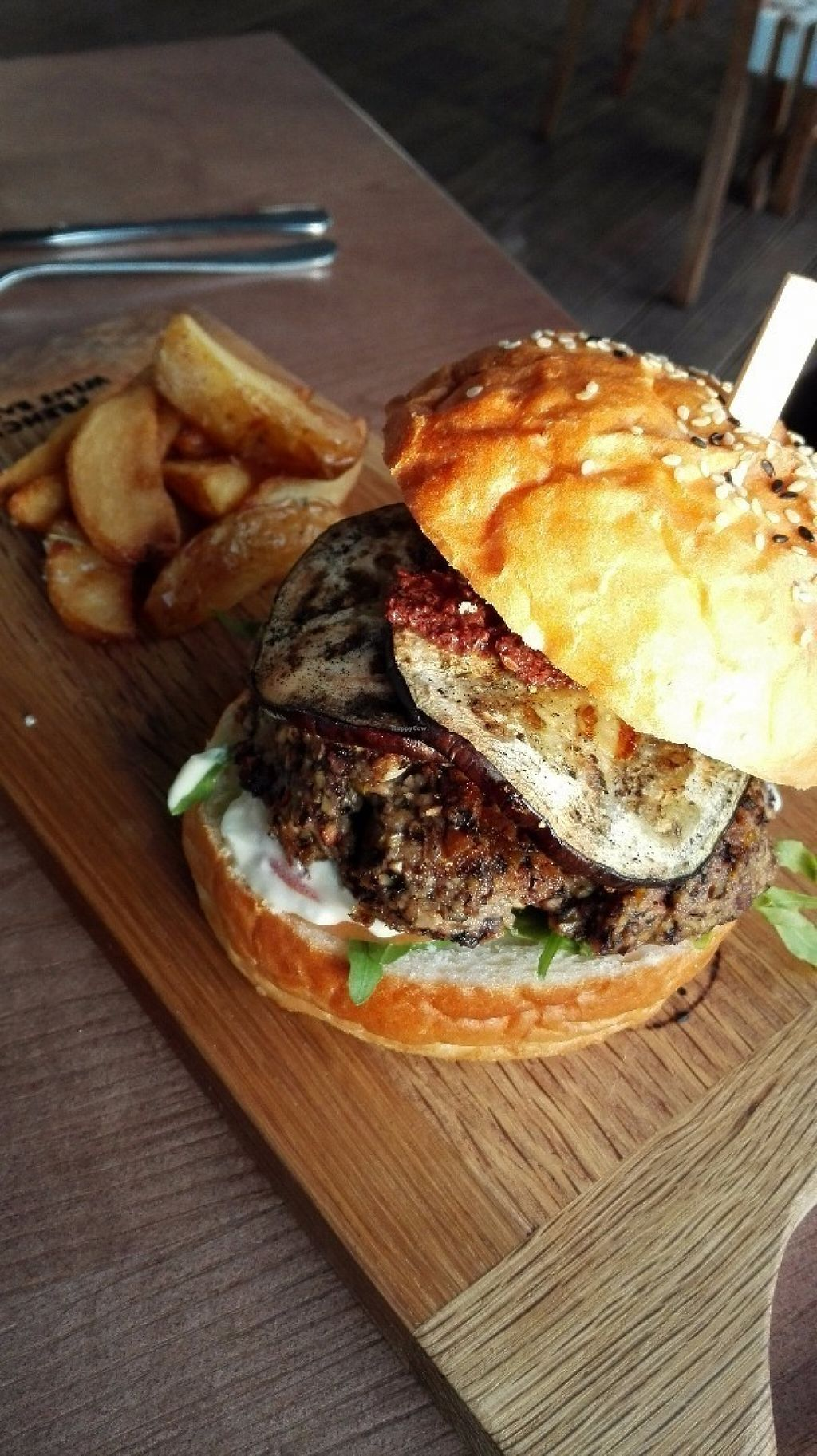"""Photo of CLOSED: Nomad Restaurant  by <a href=""""/members/profile/NatashaV"""">NatashaV</a> <br/>Vegan bean burger with grilled aubergine, Moroccan olive pesto and vegan mozzarella <br/> July 28, 2016  - <a href='/contact/abuse/image/69554/162848'>Report</a>"""