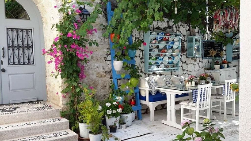 "Photo of Ruzgar Hotel Alacati Restaurant  by <a href=""/members/profile/Munic"">Munic</a> <br/>Breakfast under pomegranate tree <br/> February 12, 2016  - <a href='/contact/abuse/image/69565/135956'>Report</a>"