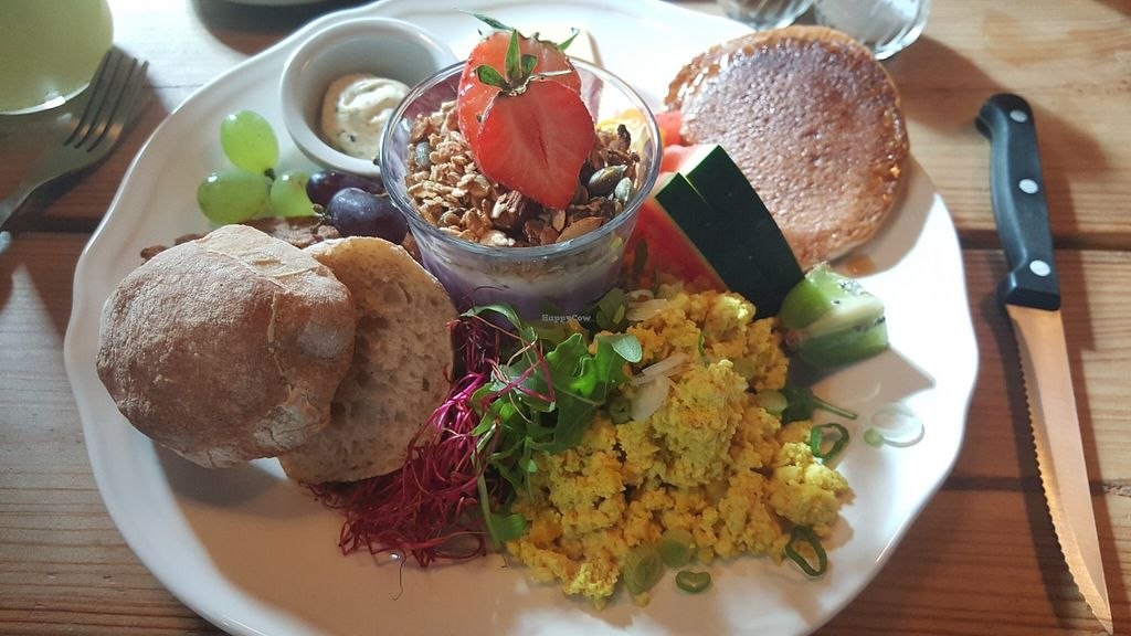 "Photo of Kaffestuen Vesterbro  by <a href=""/members/profile/hejalexandra"">hejalexandra</a> <br/>Breakfast menu. American pancakes, scrambled tofu, bread, cheese, yoghurt with granola, fruit, vegetables <br/> June 19, 2016  - <a href='/contact/abuse/image/69746/154843'>Report</a>"
