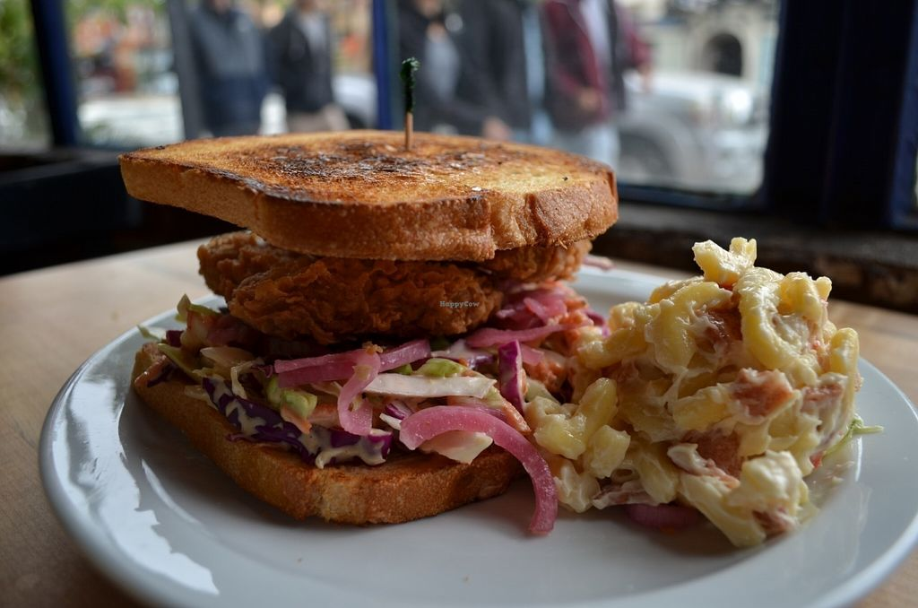 "Photo of The Butcher's Son  by <a href=""/members/profile/alexandra_vegan"">alexandra_vegan</a> <br/>Fried ""chicken"" BLAT sandwich with macaroni-bacon salad <br/> July 17, 2016  - <a href='/contact/abuse/image/70334/160370'>Report</a>"