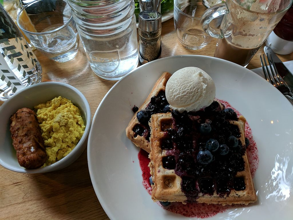 "Photo of Mildreds - Kings Cross  by <a href=""/members/profile/callyisprobablyacat"">callyisprobablyacat</a> <br/>The quinoa oat and blueberry waffles with maple syrup and ice cream, ""sausage,"" and scrambled tofu <br/> September 3, 2017  - <a href='/contact/abuse/image/70439/300437'>Report</a>"