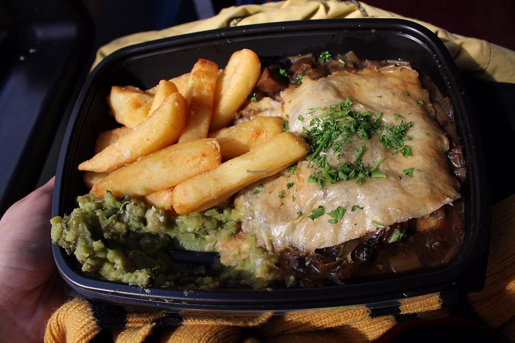 "Photo of Mildreds - Kings Cross  by <a href=""/members/profile/ericacrombie"">ericacrombie</a> <br/>Wood roasted mushroom and ale pie with minted mushy peas and fries. I got this take-away and ate it on the red double-decker bus (I apologise, Londoners) because I was super busy that day. This was really yummy and as you can see, I couldn't help but eat some before I'd even taken the photo <br/> September 23, 2017  - <a href='/contact/abuse/image/70439/307322'>Report</a>"
