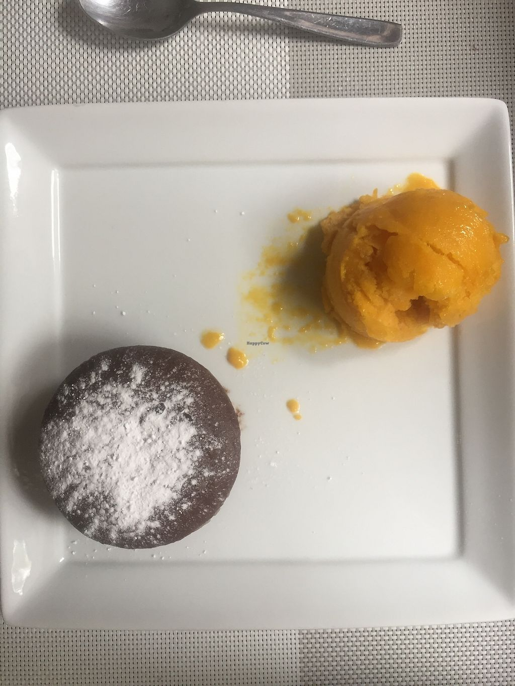 """Photo of Seitan Urban Bistro  by <a href=""""/members/profile/joegelay"""">joegelay</a> <br/>Chocolate lava cake (GREAT) with mango sorbet (meh, very frozen and not very fresh) <br/> December 31, 2017  - <a href='/contact/abuse/image/70536/341462'>Report</a>"""
