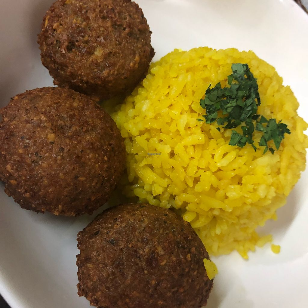 "Photo of Hummus Elijah  by <a href=""/members/profile/Poised_with_Plants"">Poised_with_Plants</a> <br/>Falafel with yellow turmeric rice  <br/> April 23, 2018  - <a href='/contact/abuse/image/70821/389983'>Report</a>"