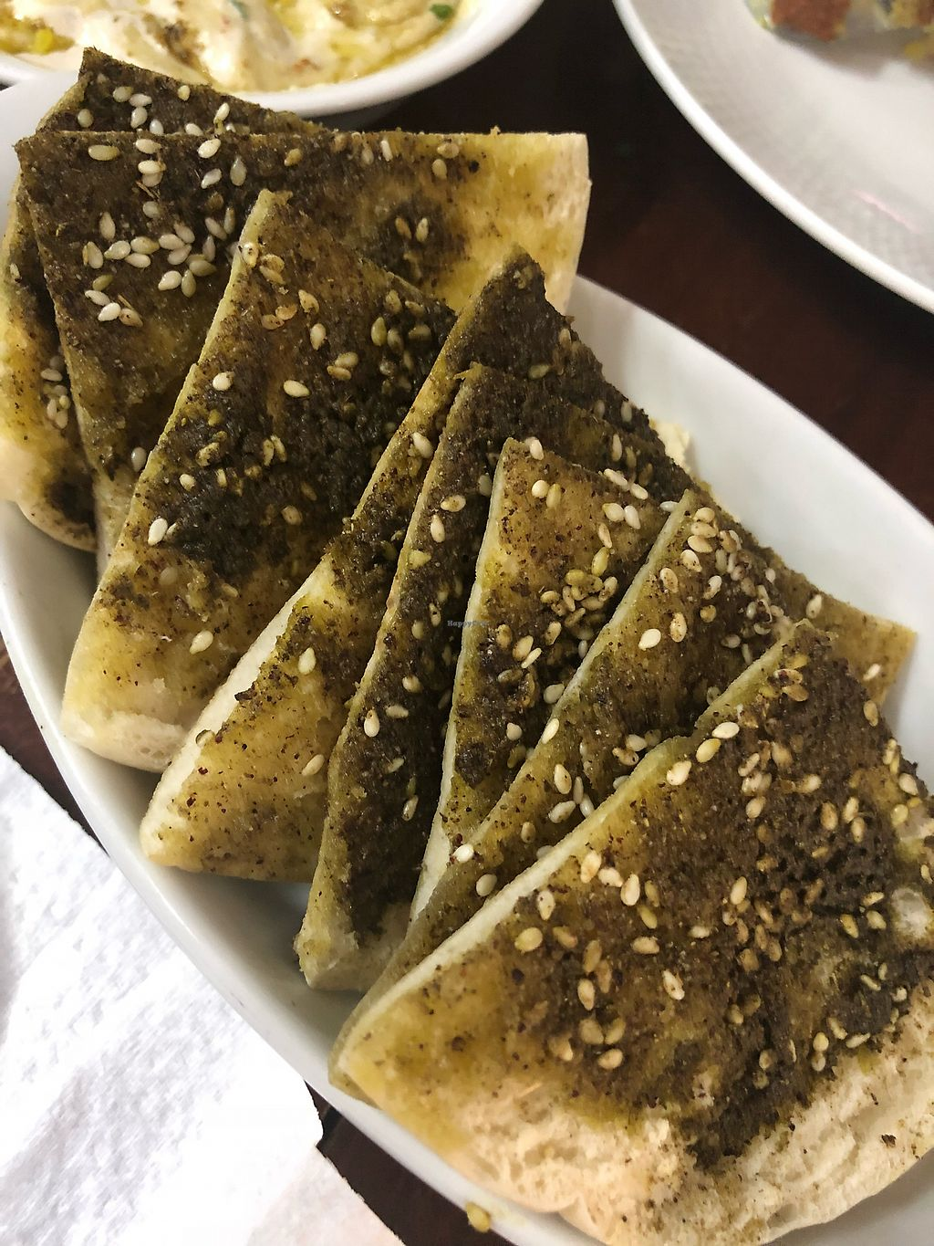 "Photo of Hummus Elijah  by <a href=""/members/profile/Poised_with_Plants"">Poised_with_Plants</a> <br/>Pita Za'atar <br/> April 23, 2018  - <a href='/contact/abuse/image/70821/389984'>Report</a>"