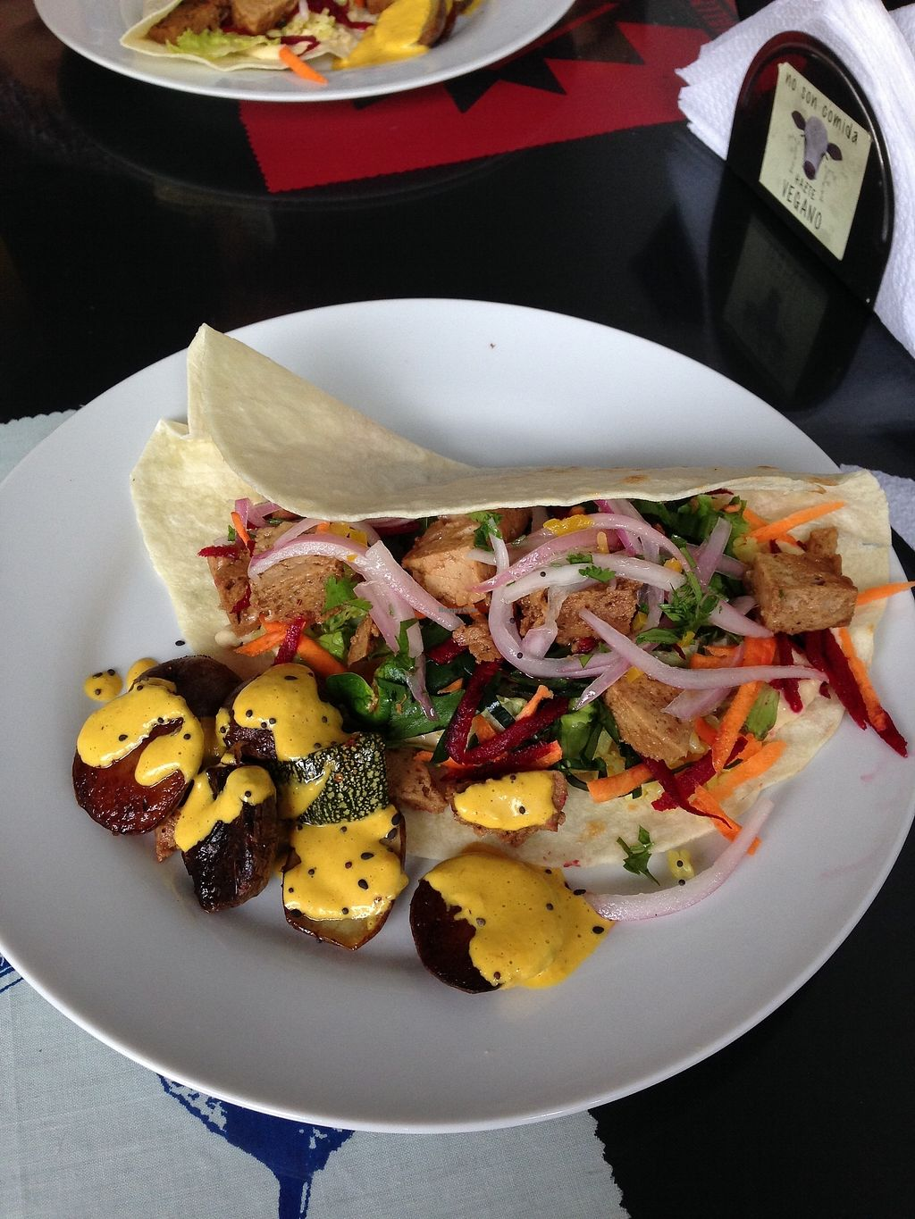 "Photo of Sinfonia Vegana  by <a href=""/members/profile/CamiloDolorier"">CamiloDolorier</a> <br/>taco with rice, seitan, hummus and veggies. potatoes and zucchini with huancaina sauce. appetizer was stuffed avocado (no picture!) <br/> September 4, 2017  - <a href='/contact/abuse/image/70859/300841'>Report</a>"