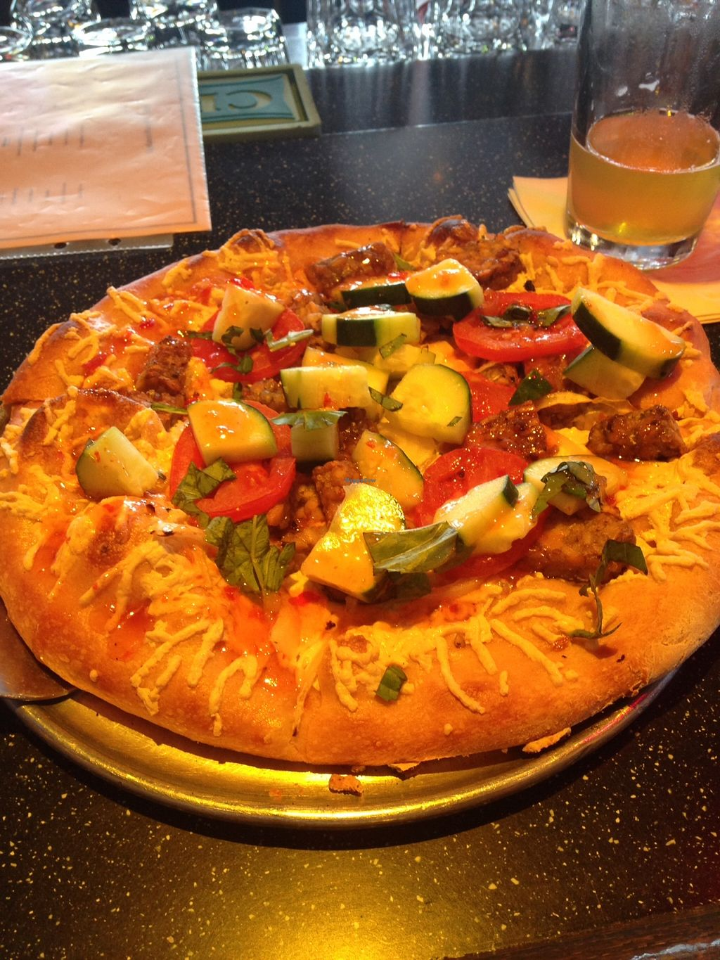"""Photo of Mellow Mushroom  by <a href=""""/members/profile/Manlyvegan"""">Manlyvegan</a> <br/>Vegan Thai Dye Pizza with Daiya, tempeh, cucumber, basil, tomato, and sweet chili sauce on a garlic olive oil base.  <br/> March 17, 2016  - <a href='/contact/abuse/image/71009/140326'>Report</a>"""