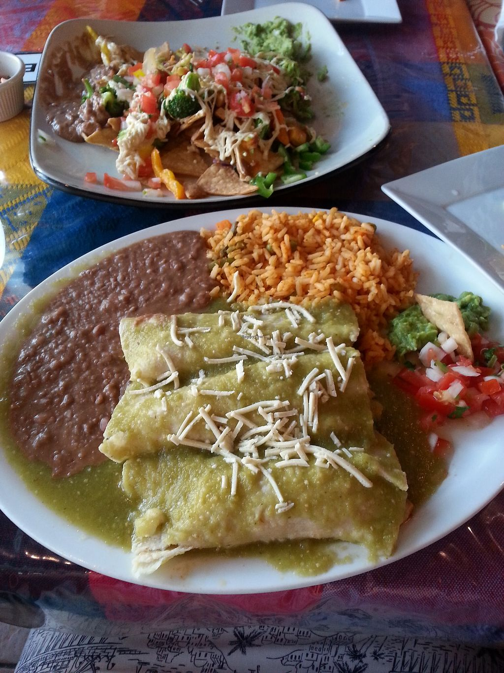 "Photo of Cantina Vallarta  by <a href=""/members/profile/LolaMeow"">LolaMeow</a> <br/>Enchiladas with salsa verde <br/> July 2, 2017  - <a href='/contact/abuse/image/71925/276045'>Report</a>"