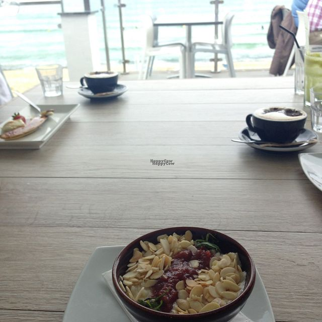 "Photo of Porthmeor Beach Cafe  by <a href=""/members/profile/Sallyliz"">Sallyliz</a> <br/>Dessert in an alcove (rice almond milk pudding with rhubarb compote and mint) <br/> September 15, 2016  - <a href='/contact/abuse/image/72398/176005'>Report</a>"