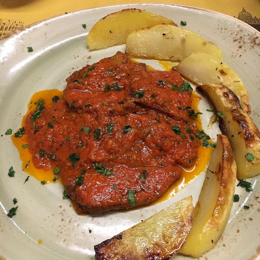 "Photo of Rifugio Romano  by <a href=""/members/profile/Lottie309"">Lottie309</a> <br/>Seitan escalopes with tomato (pizza) sauce and potato wedges <br/> February 12, 2018  - <a href='/contact/abuse/image/72423/358423'>Report</a>"