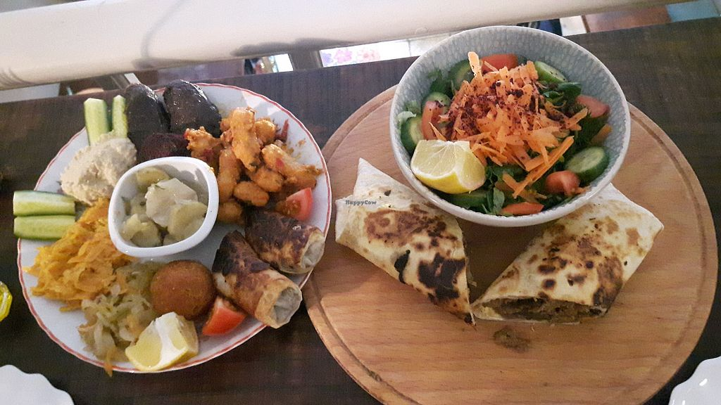 """Photo of Muhtelif Mekan  by <a href=""""/members/profile/CharityBosua"""">CharityBosua</a> <br/>Mix platter and vegan wrap (with seitan) <br/> January 5, 2018  - <a href='/contact/abuse/image/72632/343195'>Report</a>"""
