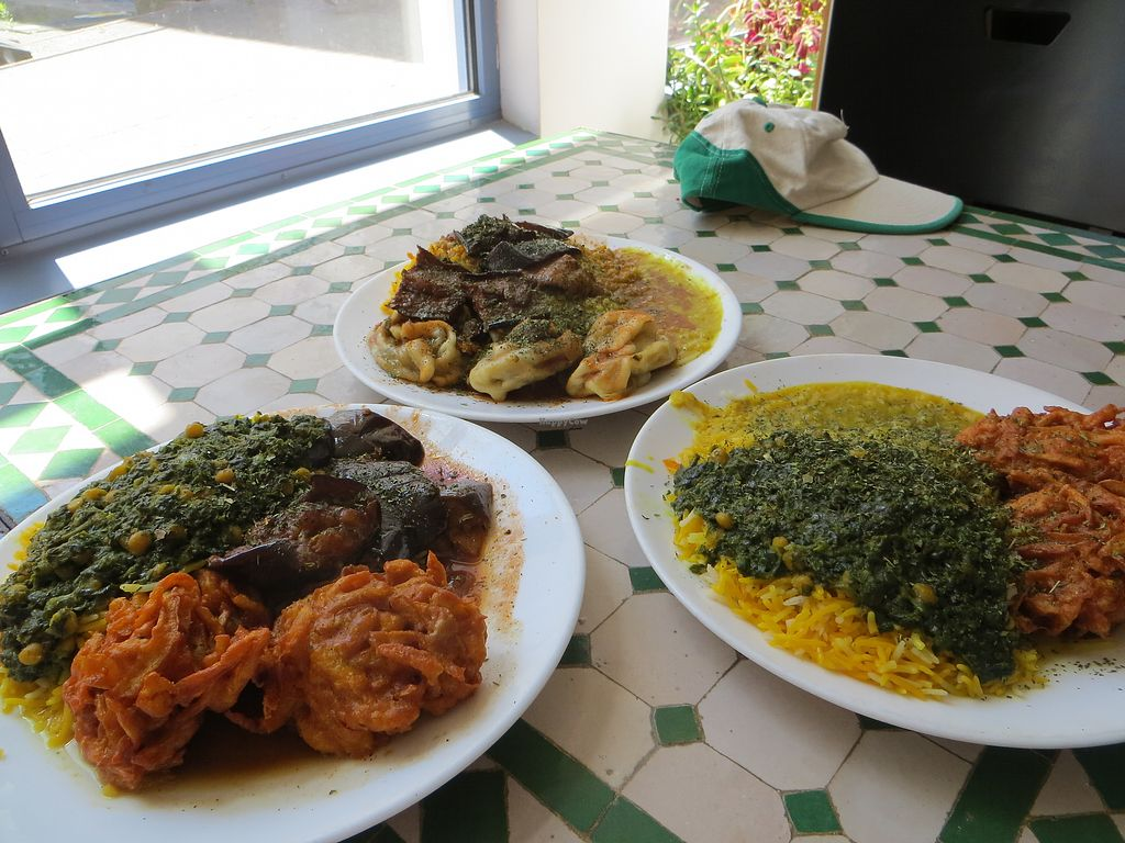 """Photo of Afghan-Eck  by <a href=""""/members/profile/NatalieBlanc"""">NatalieBlanc</a> <br/>Table full of vegan dishes <br/> July 10, 2017  - <a href='/contact/abuse/image/73130/278613'>Report</a>"""