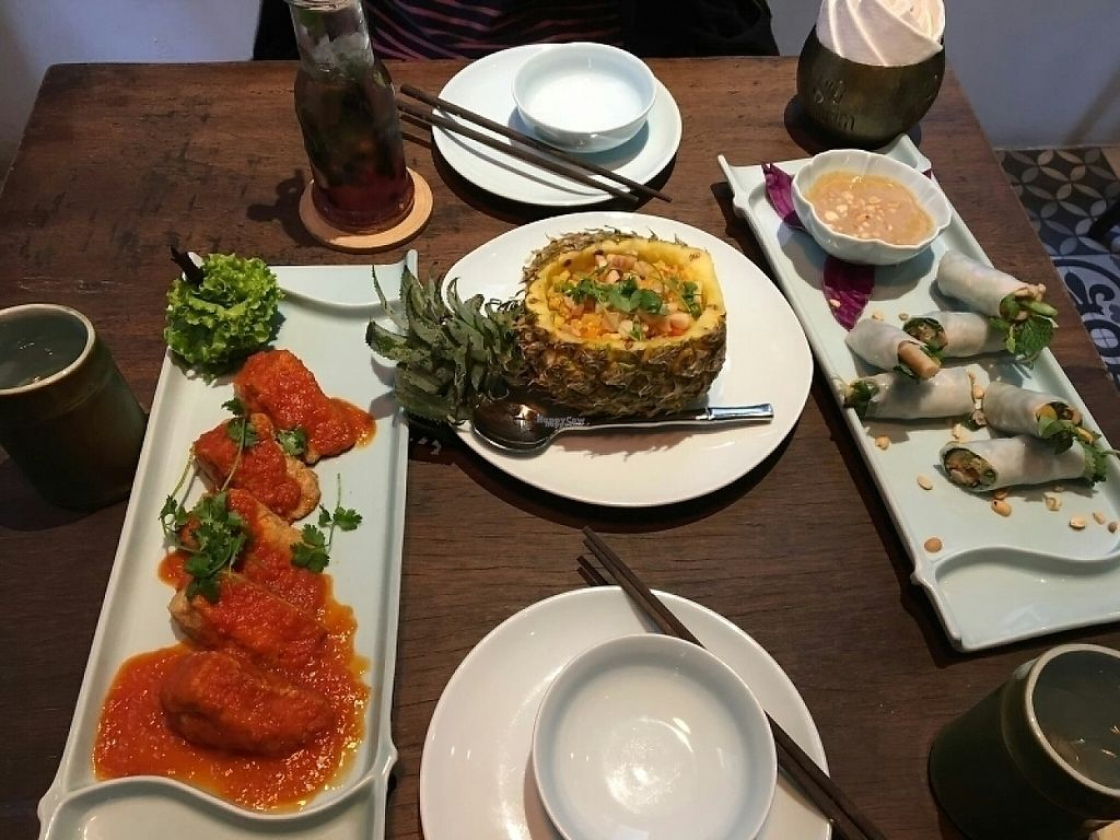 """Photo of Uu Dam Chay  by <a href=""""/members/profile/CharlotteAntoine"""">CharlotteAntoine</a> <br/>Mushroom stuffed tofu in tomato sauce, macadamia fried rice and fresh mushroom spring rolls  <br/> December 28, 2016  - <a href='/contact/abuse/image/73265/205627'>Report</a>"""
