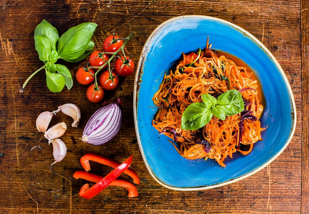 """Photo of Tony & Jen's  by <a href=""""/members/profile/JenniferAnne1987"""">JenniferAnne1987</a> <br/>Red Pepper Carotti  Red pepper sauce, basil, garlic, naturally caramelised red onion, softened tomatoes, carrot noodles & a dousing of nutritional yeast <br/> January 12, 2018  - <a href='/contact/abuse/image/73532/345732'>Report</a>"""