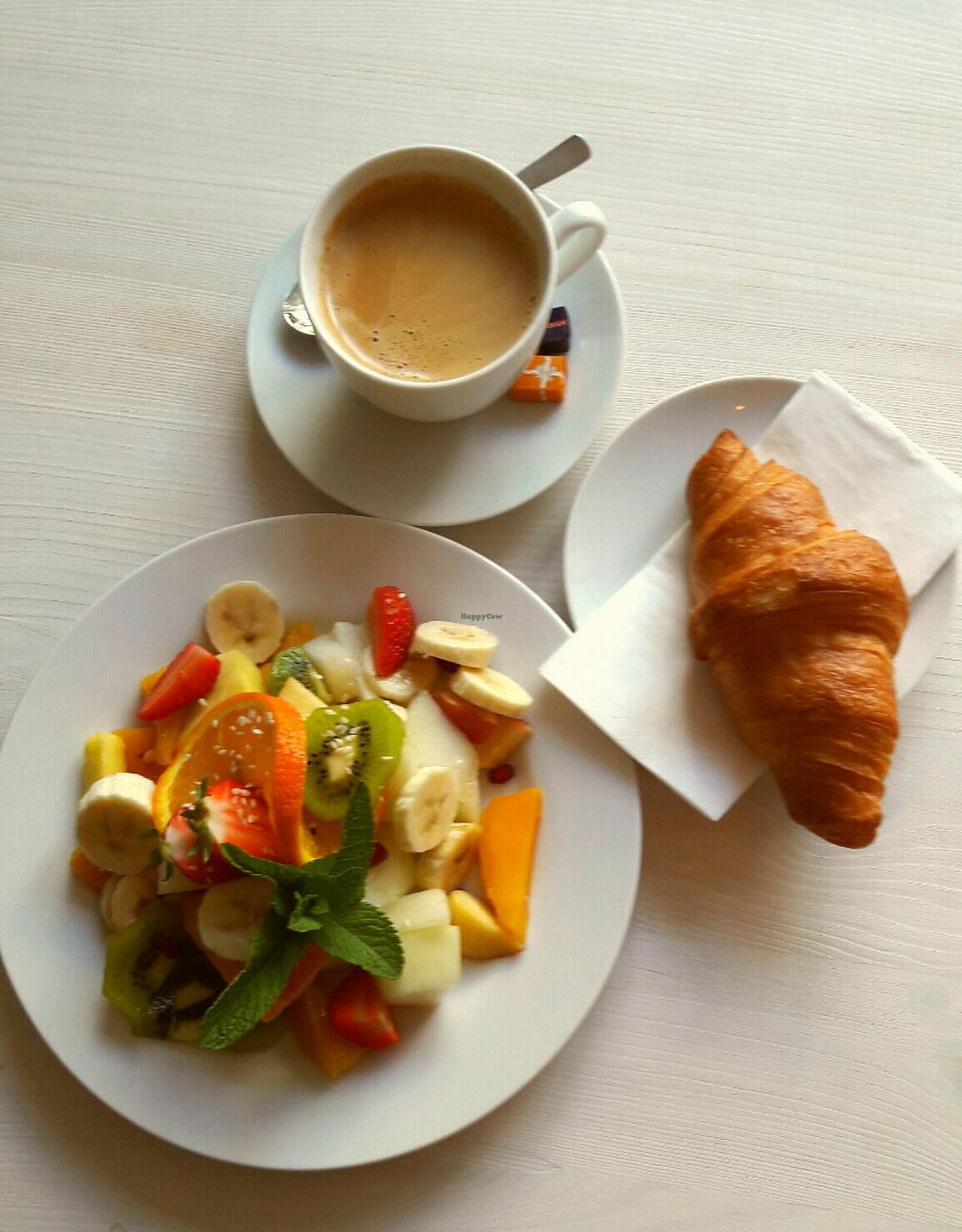 """Photo of Cafe Neue Liebe  by <a href=""""/members/profile/LieschenvanMueller"""">LieschenvanMueller</a> <br/>fresh fruit salad & coffee americano & croissant <br/> July 16, 2016  - <a href='/contact/abuse/image/73735/160311'>Report</a>"""