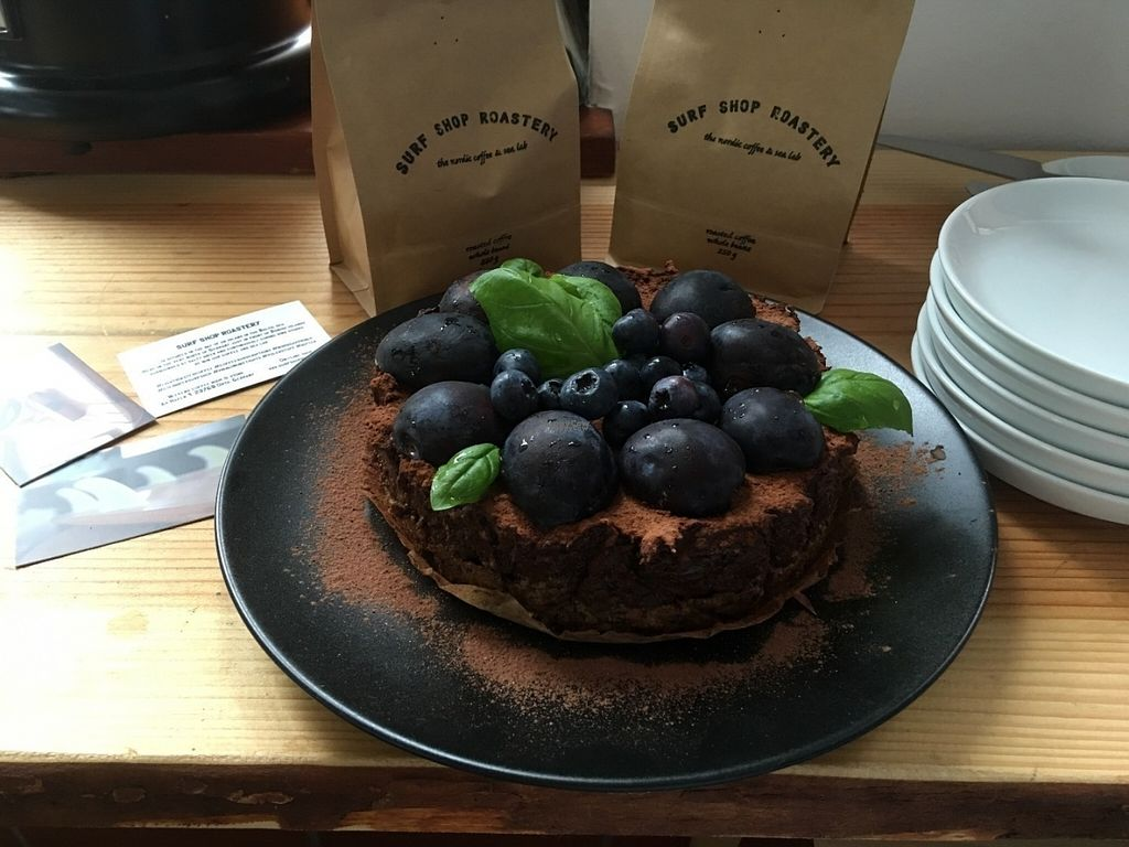 """Photo of Surf Shop Roastery  by <a href=""""/members/profile/Jana%20Kind"""">Jana Kind</a> <br/>Blueberry Plum Raw Chocolate Cake <br/> September 11, 2016  - <a href='/contact/abuse/image/73901/175031'>Report</a>"""