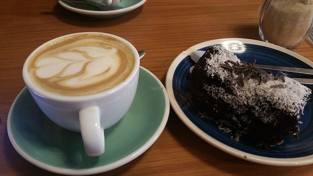 """Photo of Pum Pum Cafe  by <a href=""""/members/profile/Rosa%20veg"""">Rosa veg</a> <br/>Vegan cappuccino and cake <br/> April 16, 2017  - <a href='/contact/abuse/image/73911/249148'>Report</a>"""