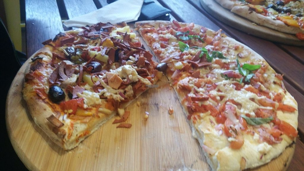 "Photo of CassellBella's Bakery Cafe  by <a href=""/members/profile/KatieBatty"">KatieBatty</a> <br/>Half and half vegan pizza <br/> September 6, 2016  - <a href='/contact/abuse/image/73946/173924'>Report</a>"