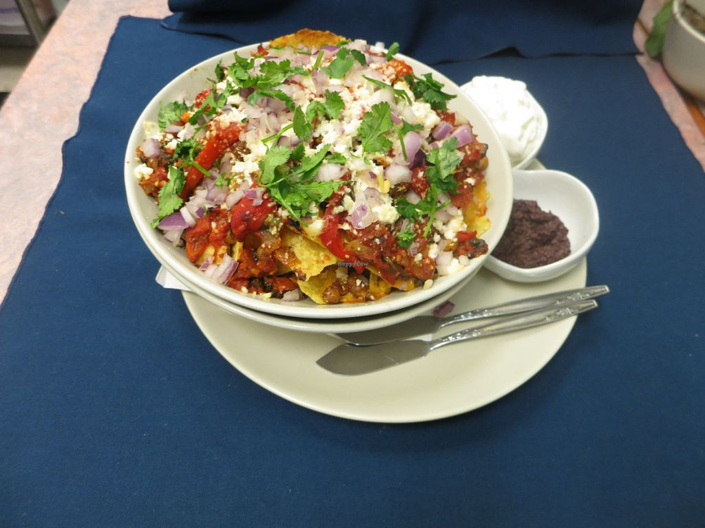 """Photo of Infinitea  by <a href=""""/members/profile/infinitea%40mail.com"""">infinitea@mail.com</a> <br/>Our Famous Nachos - completely Vegetarian with roast spiced chickpea/corn mix, housemade salsa, roasted red peppers, feta, cilantro and olive tepanade to dip! <br/> May 30, 2016  - <a href='/contact/abuse/image/74048/151431'>Report</a>"""