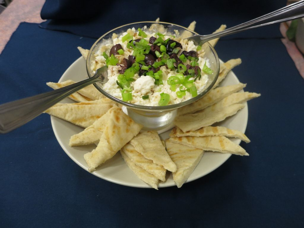 """Photo of Infinitea  by <a href=""""/members/profile/infinitea%40mail.com"""">infinitea@mail.com</a> <br/>Our twist on a 7 layer dip - completely vegetarian with housemade hummus, bubba ganoush & Tzatziki - served with toasted pita (can be substituted for tortilla chips for gluten free) <br/> May 30, 2016  - <a href='/contact/abuse/image/74048/151432'>Report</a>"""
