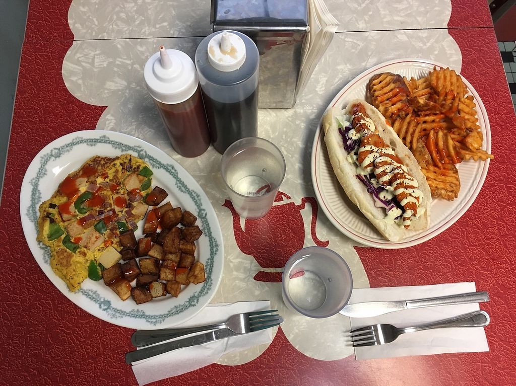 """Photo of The Tasty  by <a href=""""/members/profile/ecoRDN"""">ecoRDN</a> <br/>Western omelet and Buffalo chicken sandwich with waffle fries <br/> October 15, 2017  - <a href='/contact/abuse/image/74254/315545'>Report</a>"""
