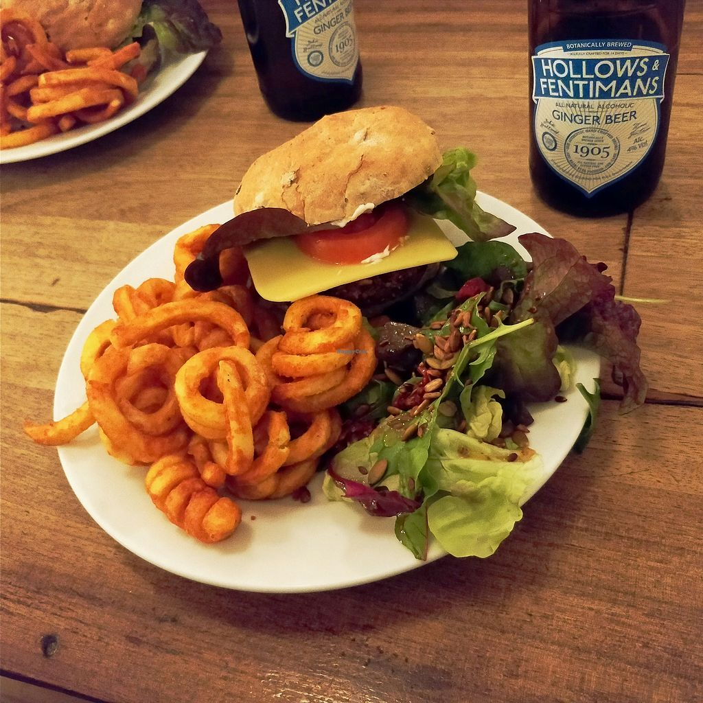 "Photo of Cafe Kino  by <a href=""/members/profile/bhupesh100"">bhupesh100</a> <br/>Vegan satay burger with curly fries and kino salad <br/> April 27, 2018  - <a href='/contact/abuse/image/7428/391545'>Report</a>"