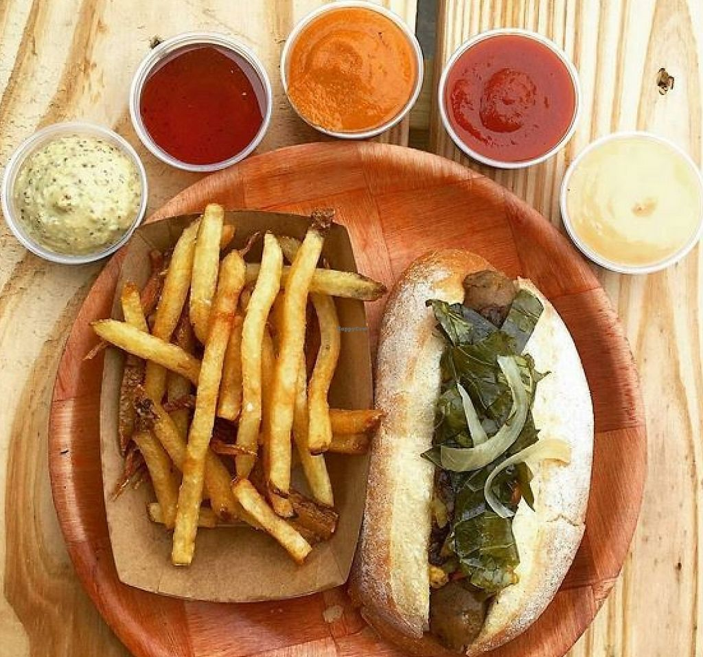 """Photo of Black Twig Cider House  by <a href=""""/members/profile/turtleveg"""">turtleveg</a> <br/>vegan sausage on Guglhupf bun, topped with Pickled Collard Greens, Spicy Peppers, Carmelized Onions, Mustard. Side of fries with various vegan sauces <br/> June 9, 2016  - <a href='/contact/abuse/image/74508/214564'>Report</a>"""