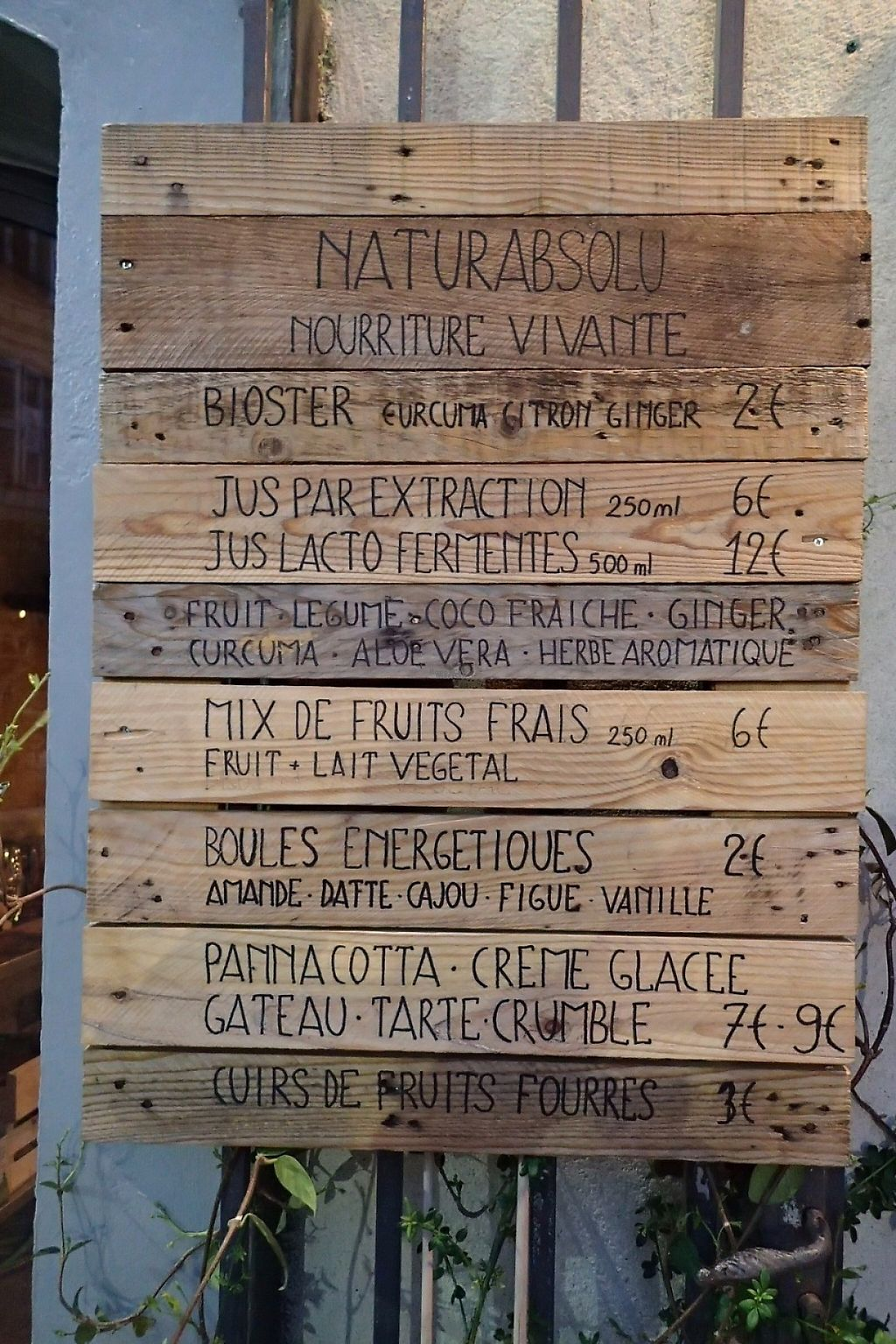 """Photo of Naturabsolu  by <a href=""""/members/profile/Tyrone"""">Tyrone</a> <br/>Wooden sign-boards outside the restaurant <br/> April 10, 2017  - <a href='/contact/abuse/image/74572/246703'>Report</a>"""