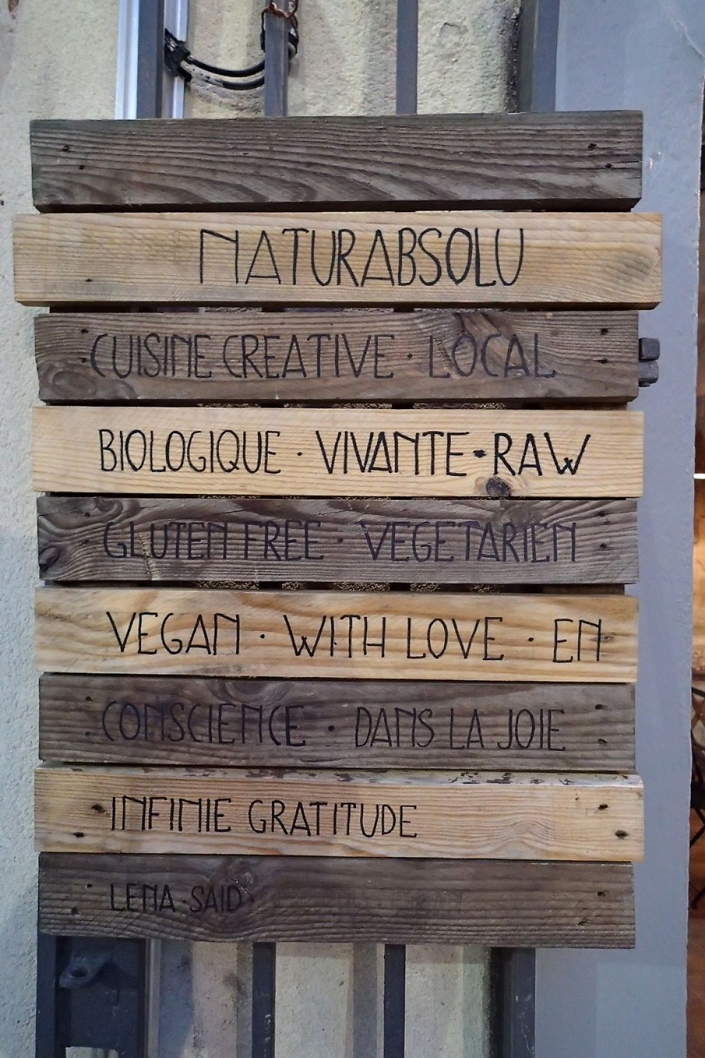 """Photo of Naturabsolu  by <a href=""""/members/profile/Tyrone"""">Tyrone</a> <br/>Wooden sign-boards outside the restaurant <br/> April 10, 2017  - <a href='/contact/abuse/image/74572/246704'>Report</a>"""