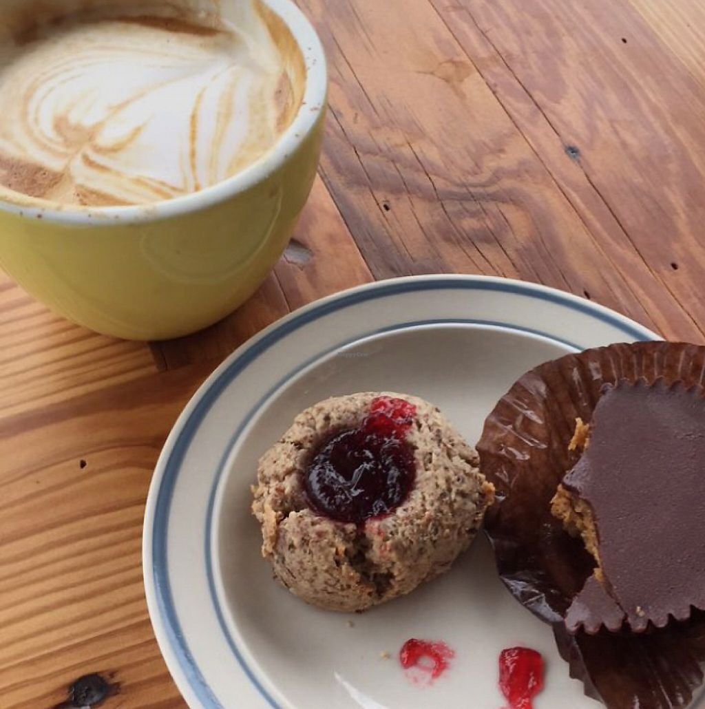 "Photo of 2tarts Bakery  by <a href=""/members/profile/mscandicerose"">mscandicerose</a> <br/>Vegan PB cup, almond thumbprint cookie with raspberry jam, almond milk latte <br/> May 21, 2017  - <a href='/contact/abuse/image/75046/261007'>Report</a>"