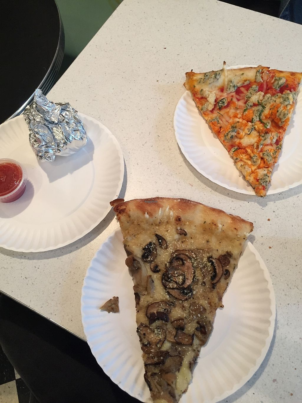 "Photo of Screamer's Pizzeria  by <a href=""/members/profile/Yasminesan"">Yasminesan</a> <br/>Pizza slices and dough balls wrapped to go (mushroom one was amazing!) <br/> October 29, 2017  - <a href='/contact/abuse/image/75081/319760'>Report</a>"