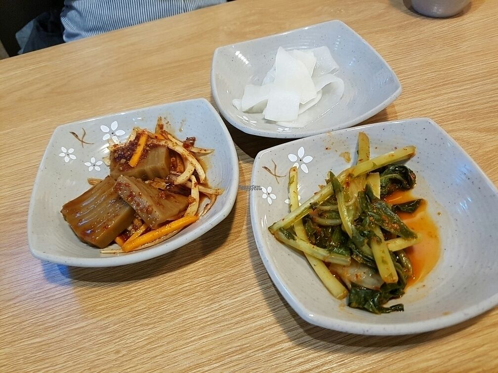 """Photo of CLOSED: MeMilGongBang - Gangnam - 메밀공방 강남역점  by <a href=""""/members/profile/mfrenette"""">mfrenette</a> <br/>Side dishes. Acorn jelly and pickled radish are vegan, greens have a seafood in them <br/> October 22, 2016  - <a href='/contact/abuse/image/75133/183512'>Report</a>"""