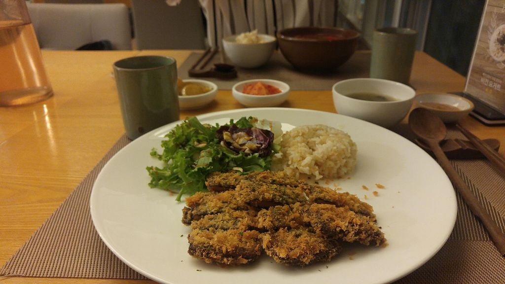"""Photo of Vegenarang  by <a href=""""/members/profile/GabrielaVillafr%C3%A1dez"""">GabrielaVillafrádez</a> <br/>- 'Pork' cutlet with rice - Jjigae - Korean sides <br/> January 9, 2018  - <a href='/contact/abuse/image/75142/344551'>Report</a>"""