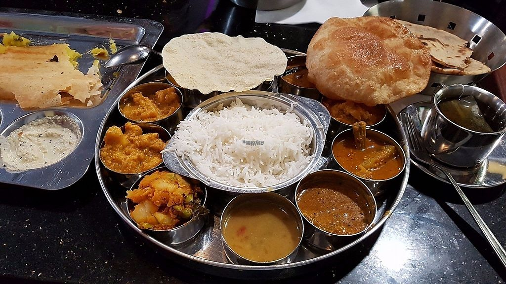 """Photo of Saravanaa Bhavan  by <a href=""""/members/profile/SusiKummer"""">SusiKummer</a> <br/>Saravanaa Special Meals for 15€ (Ordered the vegan version) - Loved it <br/> April 16, 2017  - <a href='/contact/abuse/image/75244/248940'>Report</a>"""