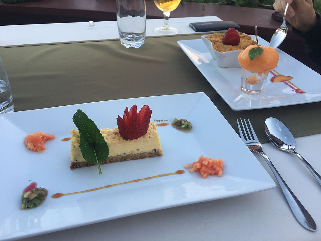 """Photo of CLOSED: Olives Restaurante  by <a href=""""/members/profile/Egypt1am-"""">Egypt1am-</a> <br/>passion fruit cheesecake (V) and apple raisin crumble (VE) nom nom nom <br/> July 1, 2017  - <a href='/contact/abuse/image/75356/275760'>Report</a>"""