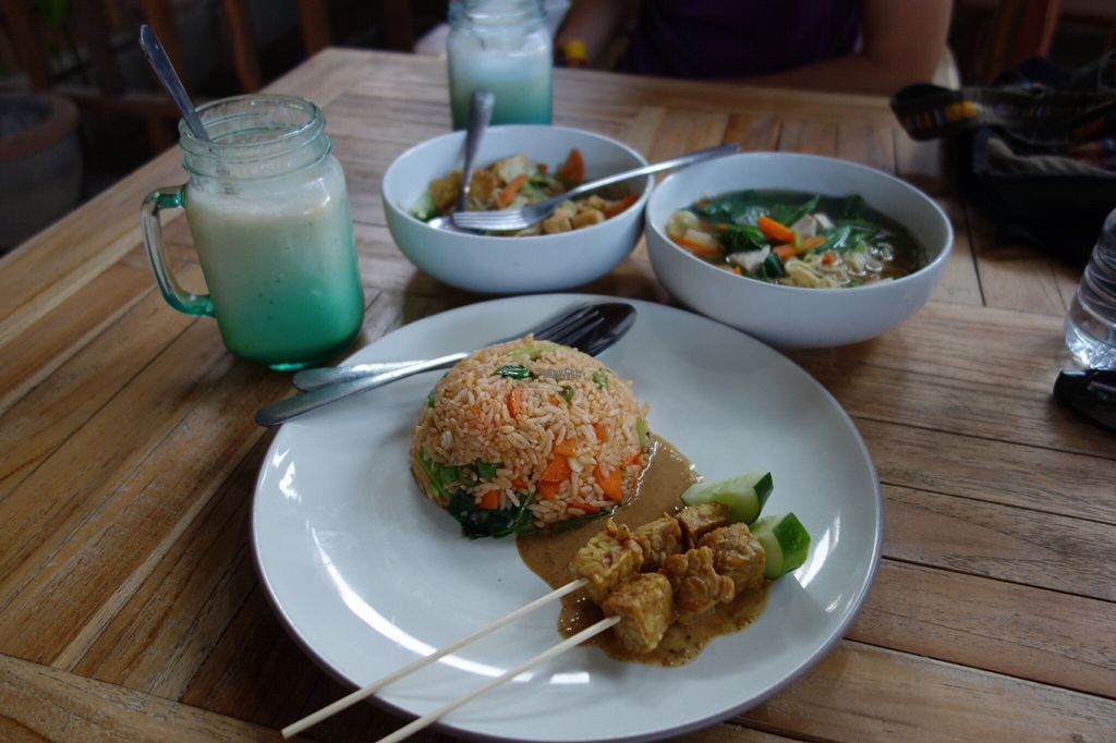 """Photo of Bali Maitreya Cafe  by <a href=""""/members/profile/mirjam"""">mirjam</a> <br/>Counter clockwise starting at the front: nasi goreng with satay, noodle soup, gado gado and banana juice <br/> September 16, 2016  - <a href='/contact/abuse/image/75459/176080'>Report</a>"""