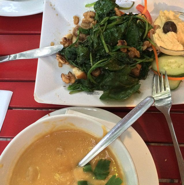 """Photo of Cafe V  by <a href=""""/members/profile/Kreuzkaro"""">Kreuzkaro</a> <br/>sweet potato peanut soup and spinac salad  <br/> September 15, 2016  - <a href='/contact/abuse/image/7568/176024'>Report</a>"""