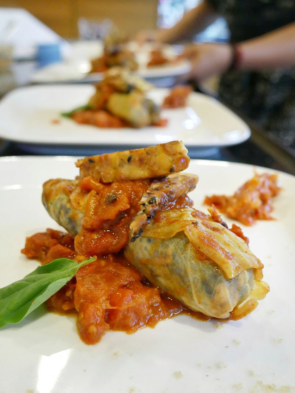 "Photo of Vegan Supper Club Bangkok  by <a href=""/members/profile/VeganCrush"">VeganCrush</a> <br/>blueberry rice filled cabbage in tomato sugo and roasted sesame tempeh <br/> December 16, 2017  - <a href='/contact/abuse/image/75708/336007'>Report</a>"