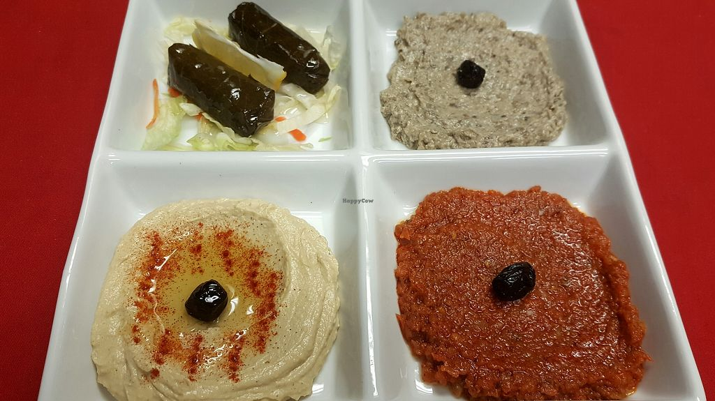 """Photo of Mediterrano Turkish and Mediterranean Cuisine  by <a href=""""/members/profile/RamazanGenc"""">RamazanGenc</a> <br/>Meze platter: Humus, babagannush, salsa and grspe leaves <br/> March 9, 2018  - <a href='/contact/abuse/image/75961/368294'>Report</a>"""