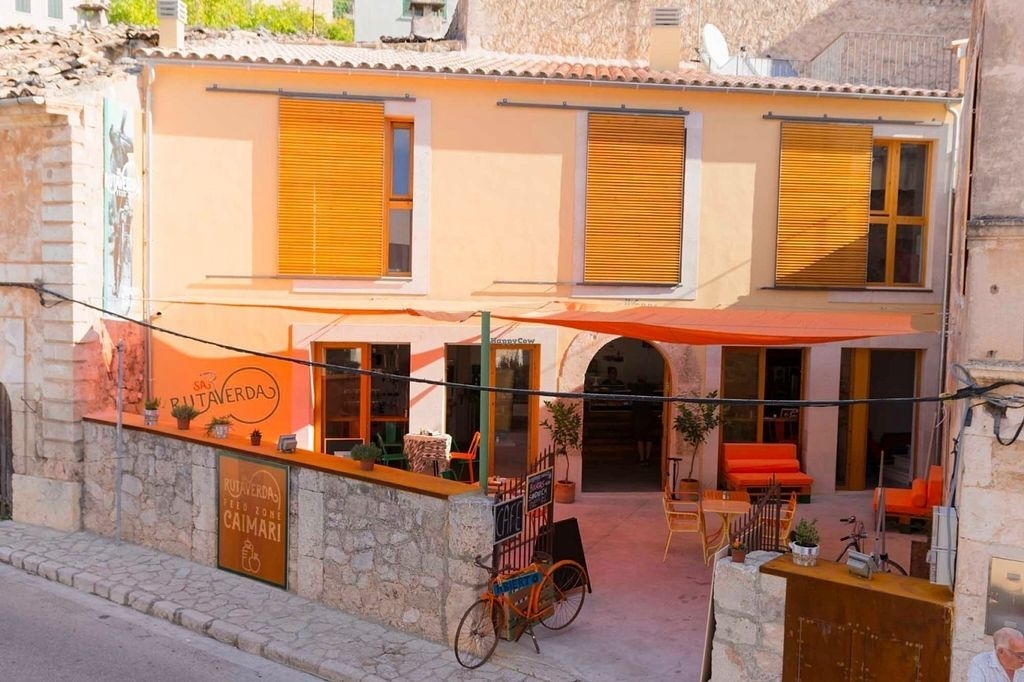 """Photo of Sa Ruta Verda  by <a href=""""/members/profile/LennartBjolgerud"""">LennartBjolgerud</a> <br/>Lovely courtyard, fresh juices, energy bars, soups, vegan and gluten free cakes <br/> July 15, 2016  - <a href='/contact/abuse/image/76280/159940'>Report</a>"""