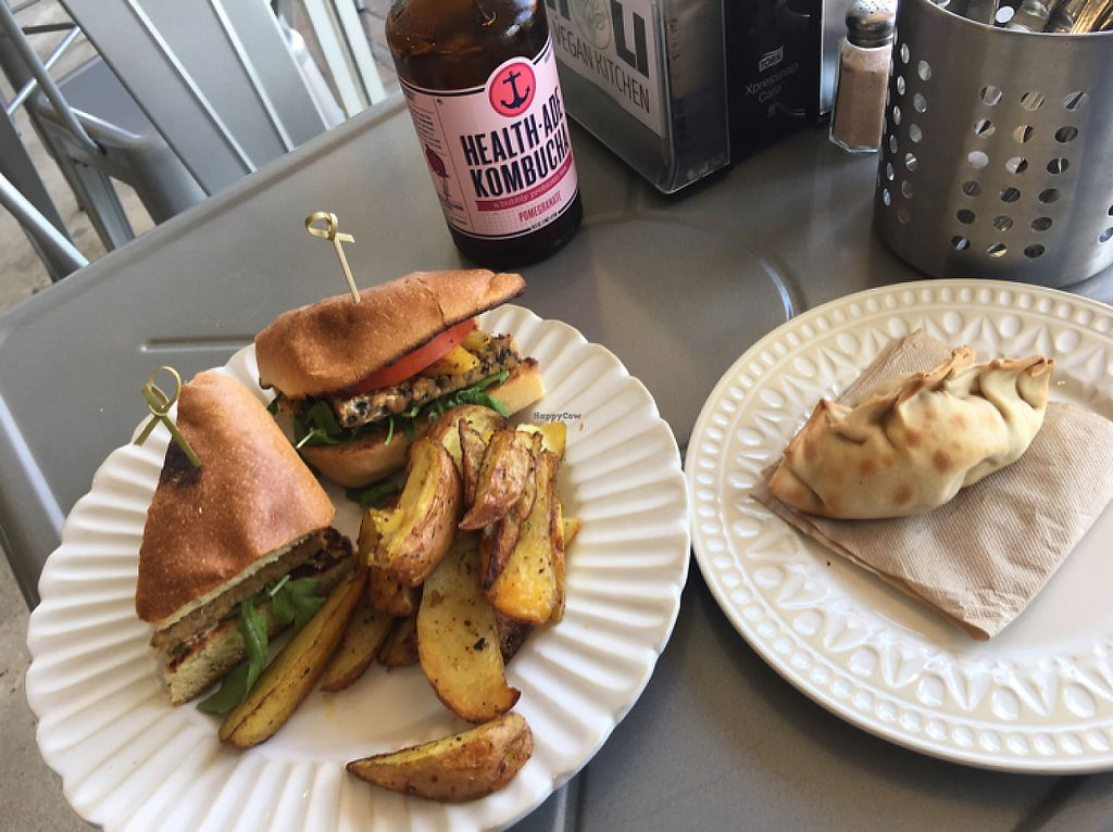 "Photo of Holi Vegan Kitchen & Bar  by <a href=""/members/profile/RichardAoun"">RichardAoun</a> <br/>corn empanadas with jerk tempeh panini <br/> May 18, 2017  - <a href='/contact/abuse/image/76286/259941'>Report</a>"
