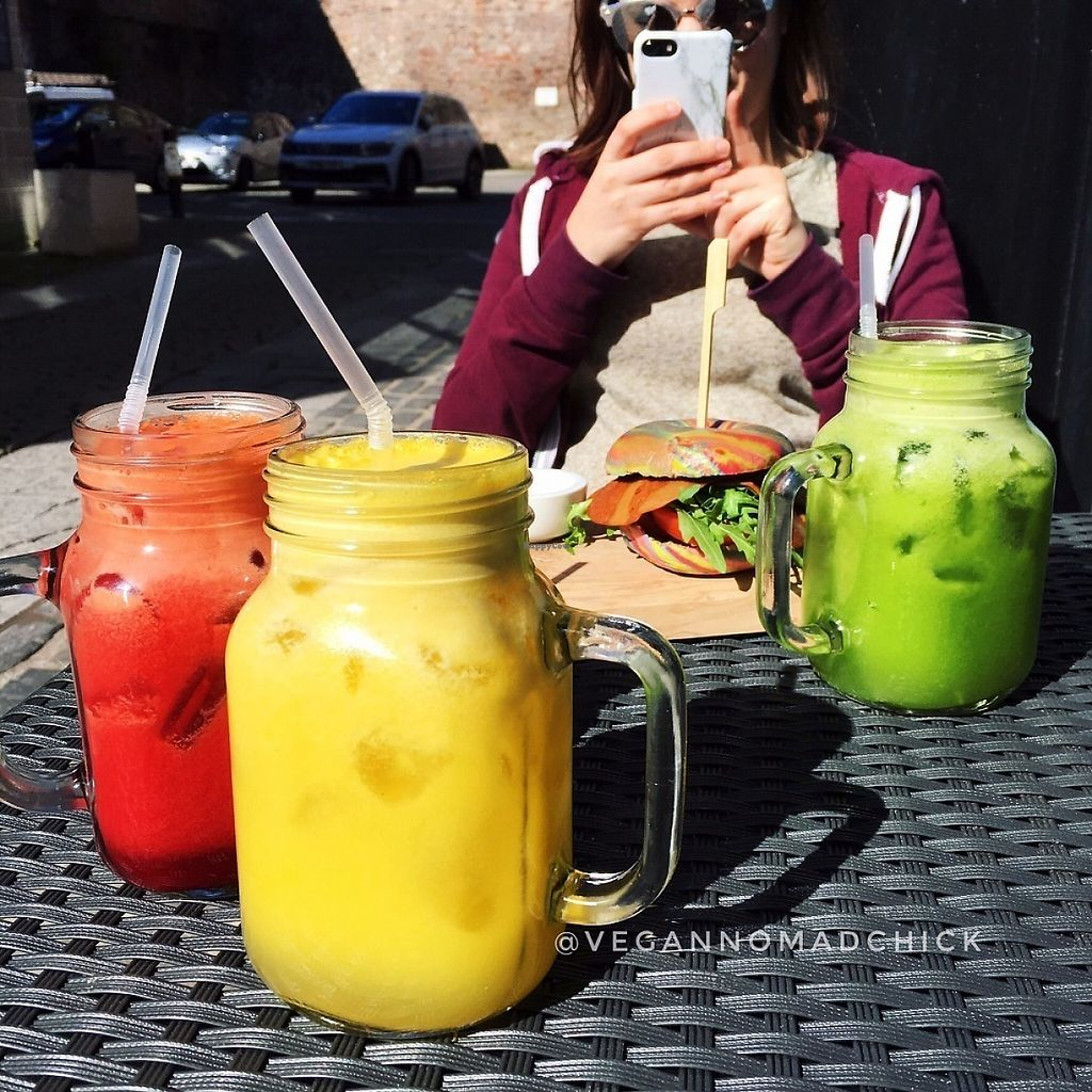 """Photo of The Flame Tree Cafe  by <a href=""""/members/profile/vegannomadchick"""">vegannomadchick</a> <br/>Fresh-squeezed juices (and vegan BLT on a rainbow bagel in the background) <br/> May 6, 2017  - <a href='/contact/abuse/image/76399/256204'>Report</a>"""