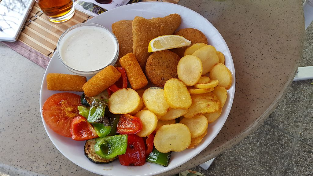 """Photo of Pizzerija Romano  by <a href=""""/members/profile/Seiashun"""">Seiashun</a> <br/>Vegan plate (fried Violife cheeses, soy patties, potato croquettes, home fries, grilled veggies, tartar sauce) <br/> October 21, 2017  - <a href='/contact/abuse/image/76507/317378'>Report</a>"""