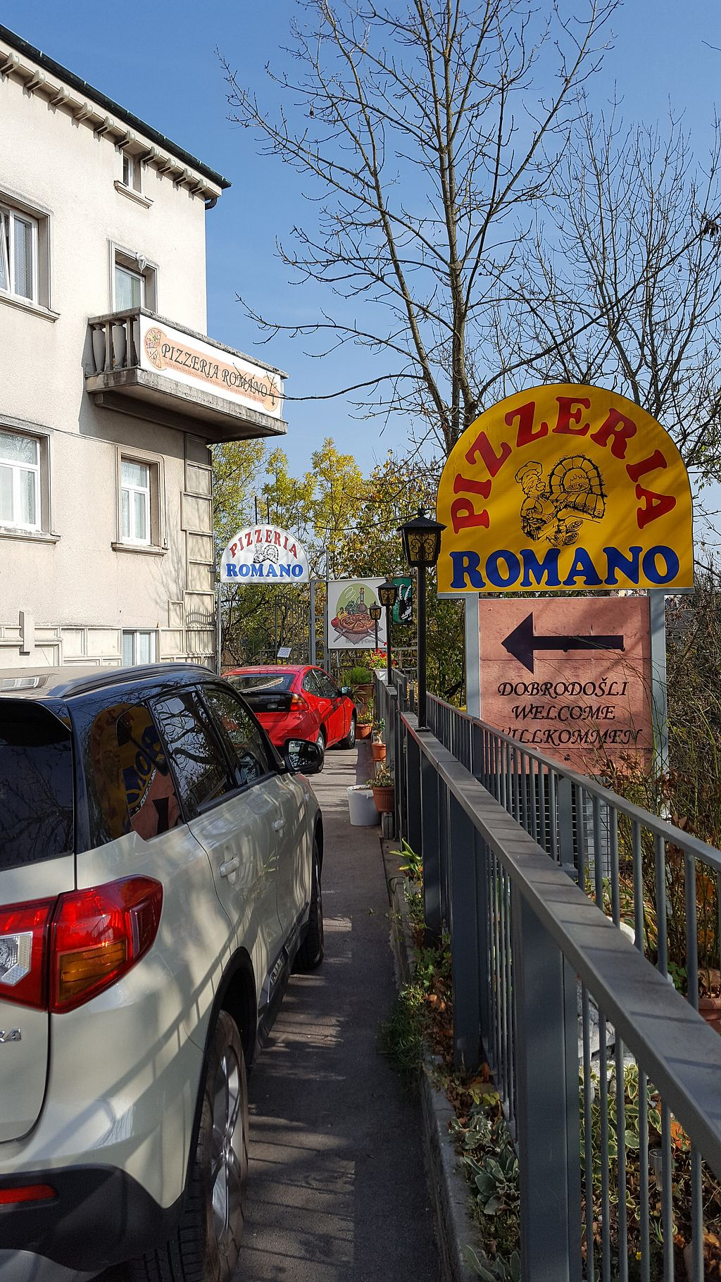 """Photo of Pizzerija Romano  by <a href=""""/members/profile/Seiashun"""">Seiashun</a> <br/>Signs leading to the restaurant <br/> October 21, 2017  - <a href='/contact/abuse/image/76507/317379'>Report</a>"""