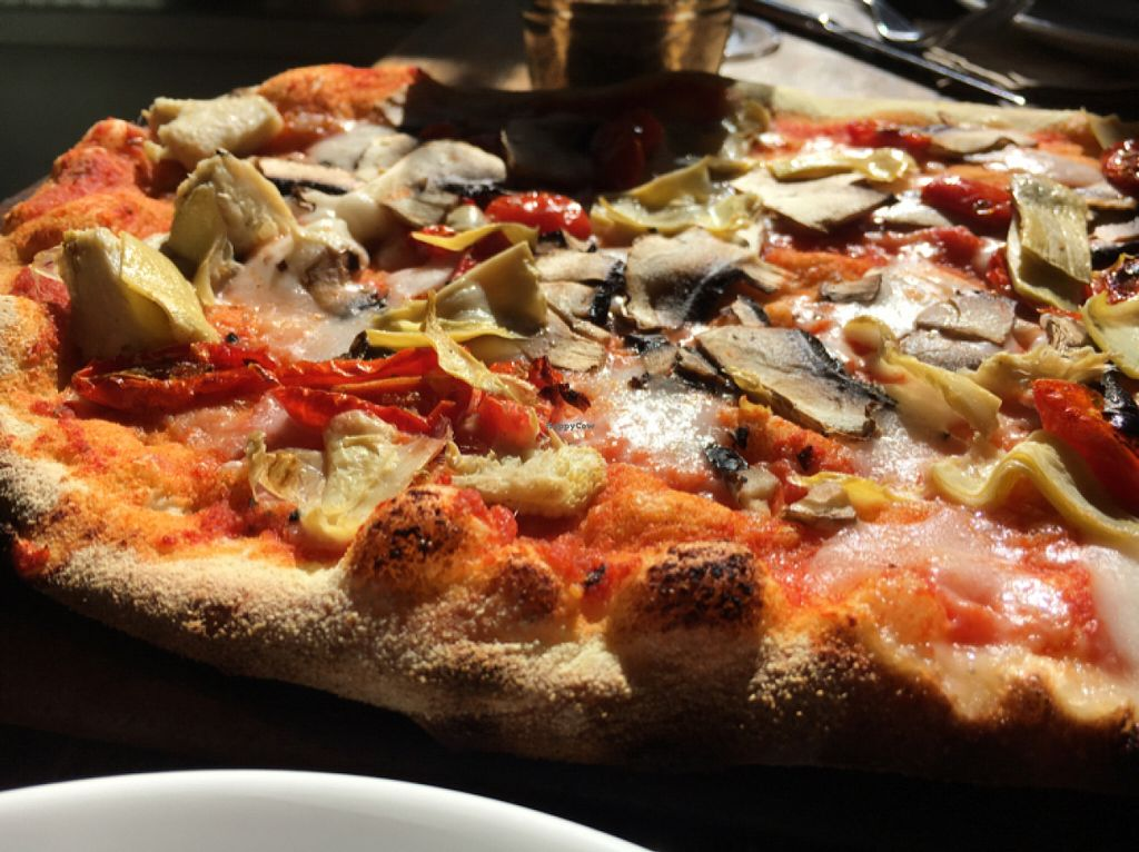 """Photo of Zizzi  by <a href=""""/members/profile/hack_man"""">hack_man</a> <br/>vegan pizza with Mozzarisella cheese  <br/> July 30, 2016  - <a href='/contact/abuse/image/77383/163480'>Report</a>"""