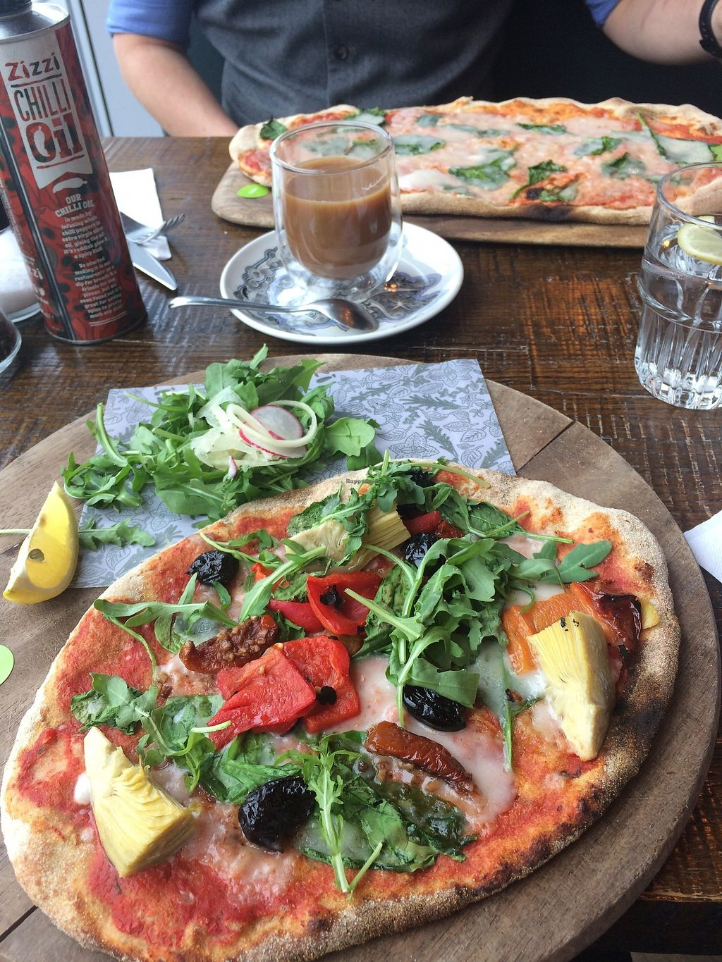 """Photo of Zizzi - Birstall  by <a href=""""/members/profile/Hoggy"""">Hoggy</a> <br/>Top Dish - Vegan 'Rustica pizza' with vegan cheese and spinach.  Bottom Dish - Skinny pizza 'Primavera', veganised, with side of naked slaw.  Also featuring Soya milk Coffee <br/> July 23, 2017  - <a href='/contact/abuse/image/77469/283823'>Report</a>"""
