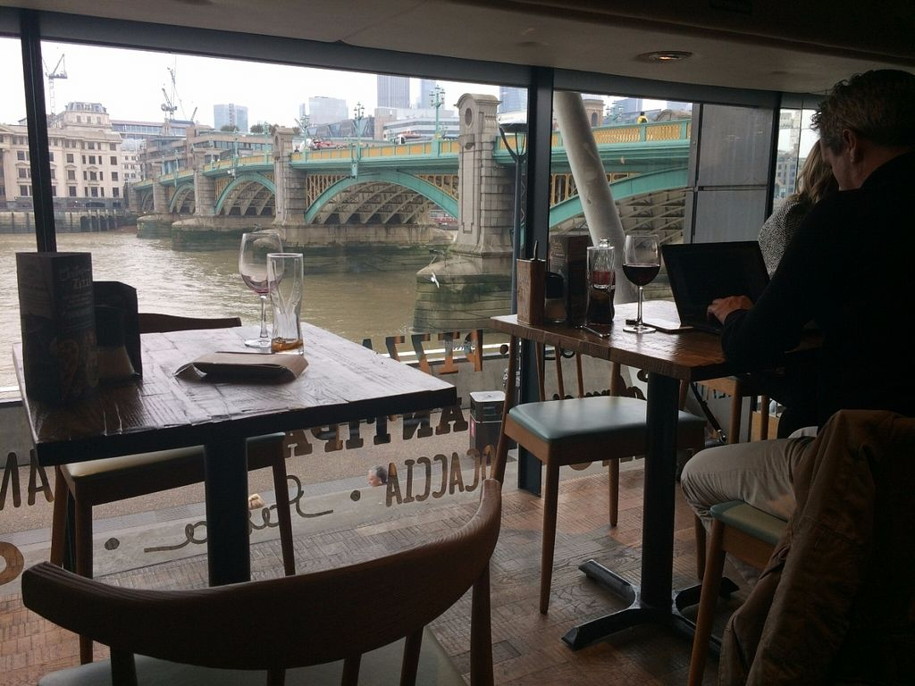 """Photo of Zizzi - Bankside  by <a href=""""/members/profile/LisaCupcake"""">LisaCupcake</a> <br/>View overlooking the Thames and Southwark Bridge <br/> October 31, 2016  - <a href='/contact/abuse/image/77477/185611'>Report</a>"""